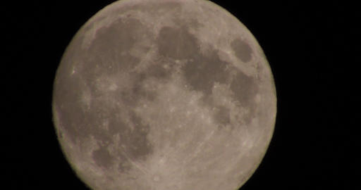Huge full moon in night skies with atmospheric distortion Live Action