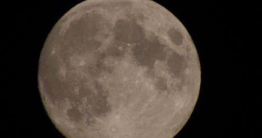 Huge full moon in night skies with atmospheric distortion Footage