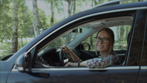 Beautiful smiling woman looking out car window Footage