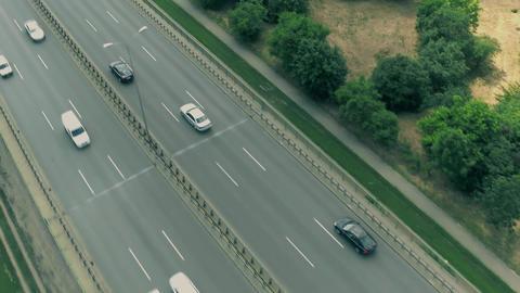 Aerial flyby view of highway traffic Footage