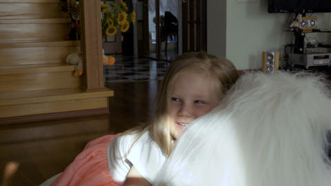 Adorable little girl sit on big soft toy and smiling Footage