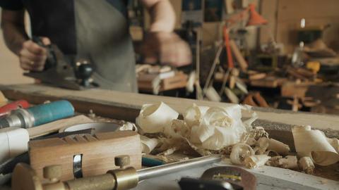 Skilled craftsman working in a workshop Footage