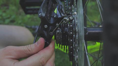 bike assembly. Mechanic repairing wheel in bicycle's workshop. Mechanic Footage