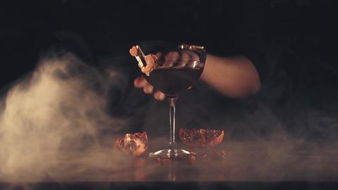 Barman serves a cocktail at the bar Footage