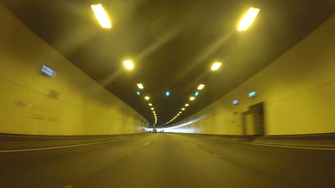 4K vehicle POV driving through freeway tunnel, real time Live Action