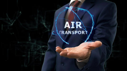 Businessman shows concept hologram Air transport on his hand Footage