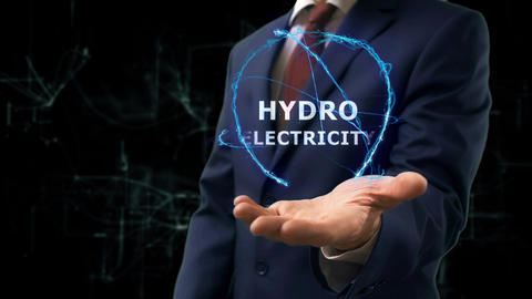 Businessman shows concept hologram Hydroelectricity on his hand Live Action