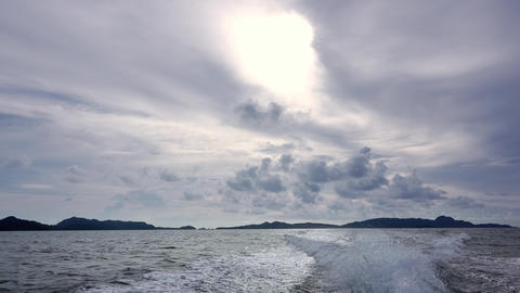 Clouds and Trace Behind the Stern of a Motor Boat Footage