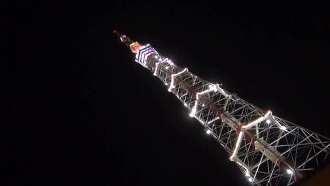 Television tower at night decorated with fires Stock Video Footage