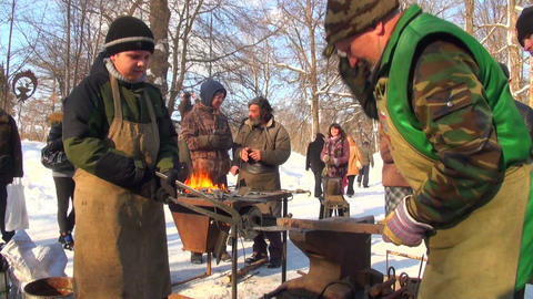 smith forges the heated iron Stock Video Footage