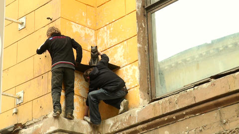 The boys climb on the wall Stock Video Footage