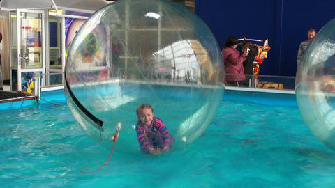Children in spheres on water Stock Video Footage