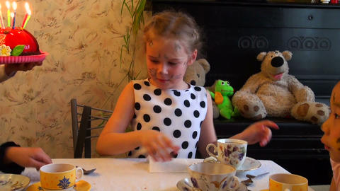 girl blows on a pie with candles Stock Video Footage