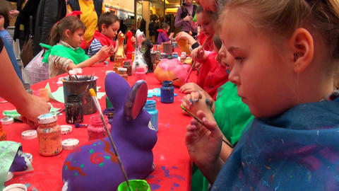 girl paints a toy Stock Video Footage