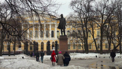 People walk near the monument To Pushkin Stock Video Footage