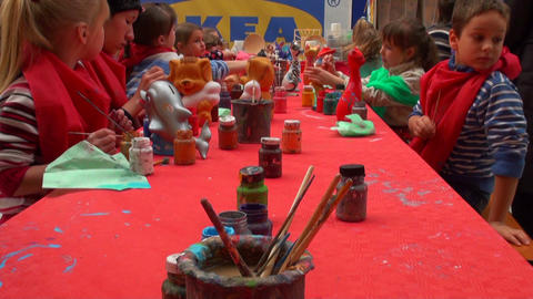 Children paint toys Footage