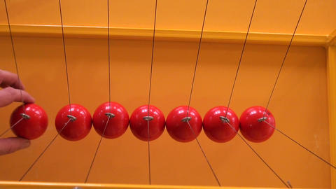Balls on strings Stock Video Footage