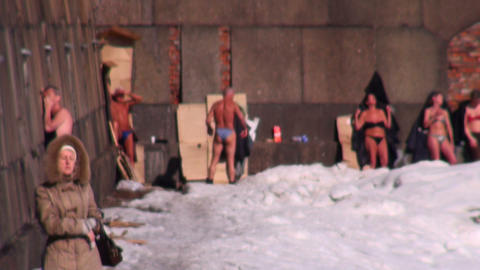 Sunbathing people in the snow Footage