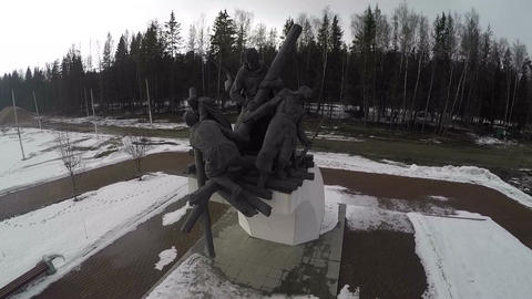 Flying over the war memorial by the road Footage