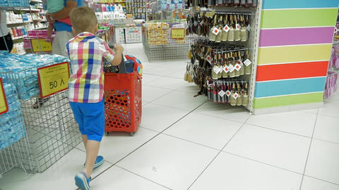 Child with shopping cart in the store Footage