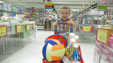 Child going shopping in the supermarket Footage