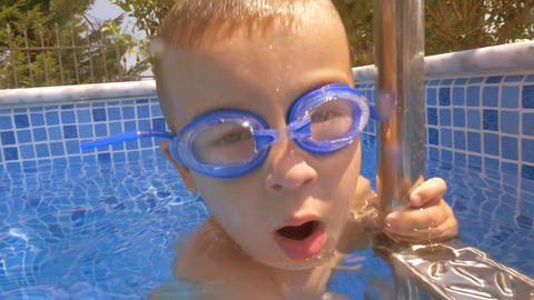Child diving in the pool on hot summer day Footage