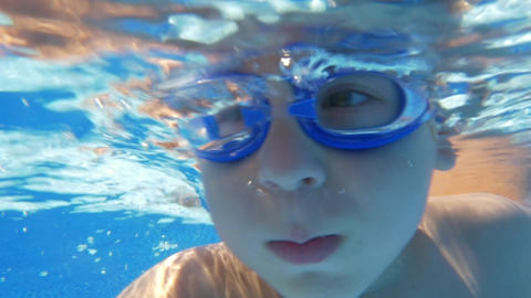 Underwater swimming of a child in goggles Footage