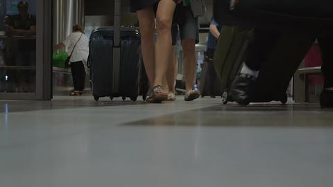 People with luggage the airport terminal Footage
