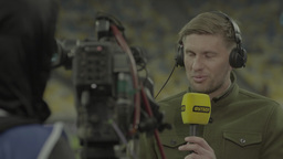 Reporter during live broadcast from the stadium Footage