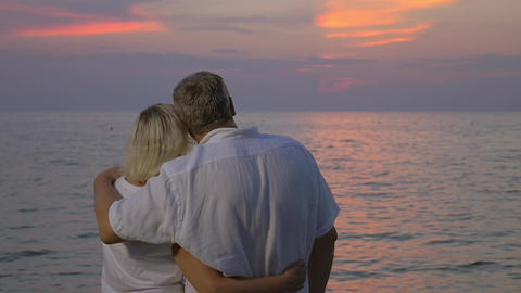 Hugs of love during sunset over sea Footage