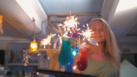 Waitress carrying cocktails with sparklers Footage