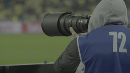 Photographer photographing the match (seen from behind) Footage