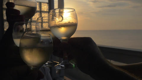 People clanging glasses in outdoor terrace at sunset Footage