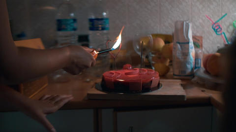 Woman firing sparklers on festive cake Footage
