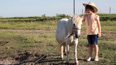 Little girl with cowboy hat and pony horse Footage