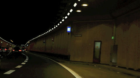Time lapse of driving though a tunnel at night Footage