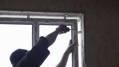 Builder installs a new window. Double glazing. 4K Footage