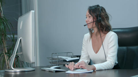 Young asian operator talking with customer in international call center Footage