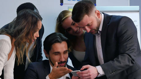 Smiling business team working with smartphone, watching somethng interesting in Footage