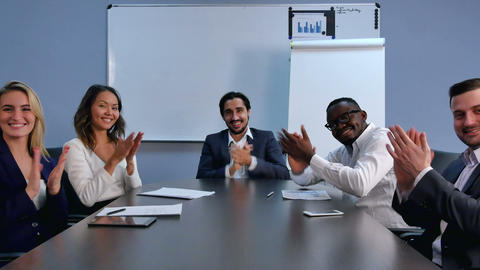 Satisfied proud business team clapping hands and looking at camera in a modern Footage