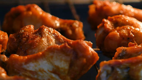 Baking hot and spicy grill chicken wings in the oven with grain processed GIF