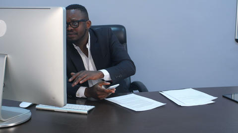 Afro-american businessman texting emails on his... Stock Video Footage