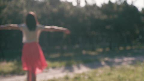 An unfocused silhouette of a young beautiful woman, who puts her hands behind Footage
