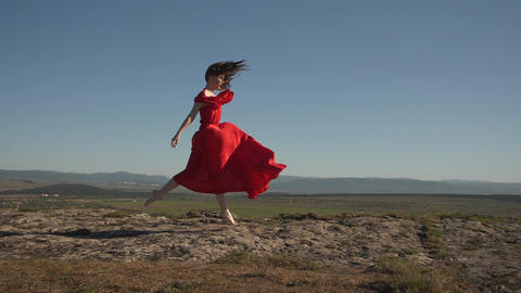 a luxurious woman in a scarlet board flies over the ground Live Action