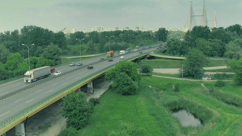 WARSAW, POLAND - JUNE 5, 2018. Aerial view of highway traffic and guyed bridge Footage