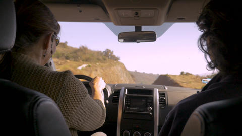 A woman driving with a male passenger talking and having a good time in a car on Footage
