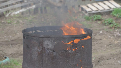 The fire burns in an old rusty barrel Footage