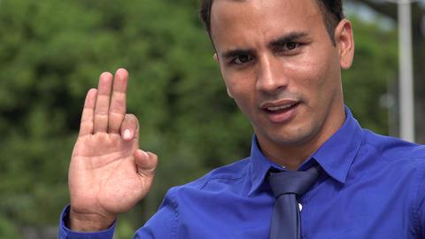 C0267 young hispanic business man spiritual gesture Live Action