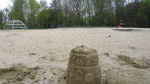 Sand Castle Destroyed By Shoes In Children's Park Live Action