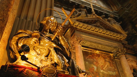 Beautiful golden statues of saints standing in Naples cathedral, religion Live Action
